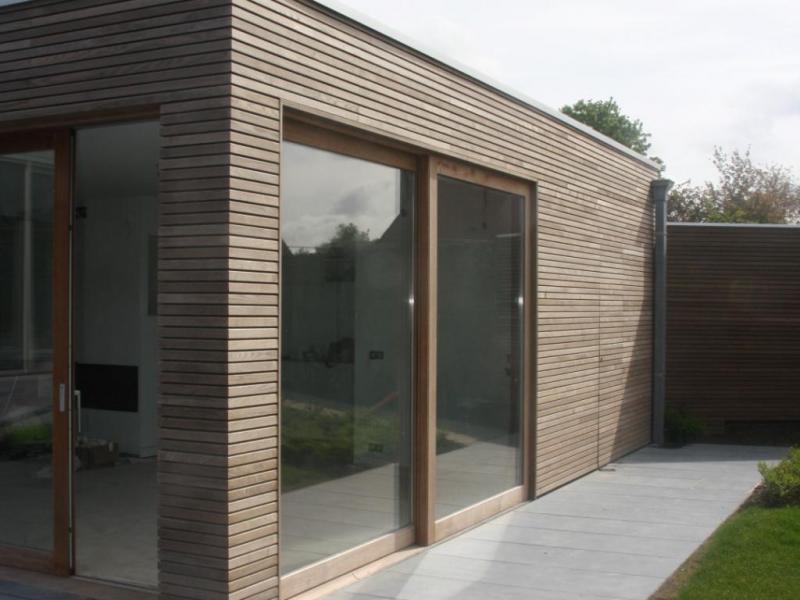 Tuinhuis tuinhuis bekleden met hout galerij foto 39 s van binnenlandse en moderne - Decoratie exterieur gevel ...